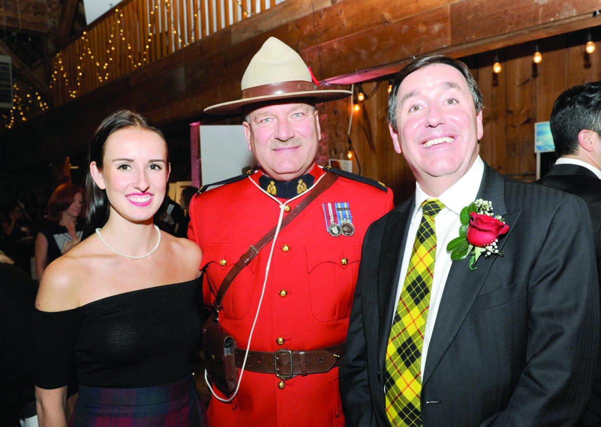 Evann Bush, RCMP Const. Terry Russel and Kriss Bush